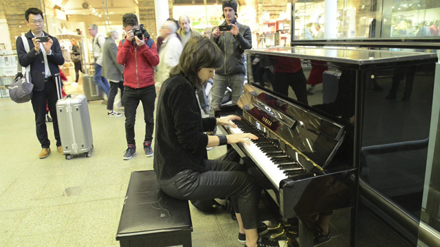 vkgoeswild playing Elton John's piano at St. Pancras Station - London