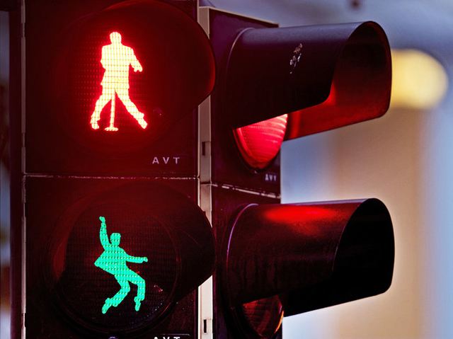 Silhouettes of Elvis Presley appear on a traffic light in Friedberg, Germany - Photo/Michael Probst