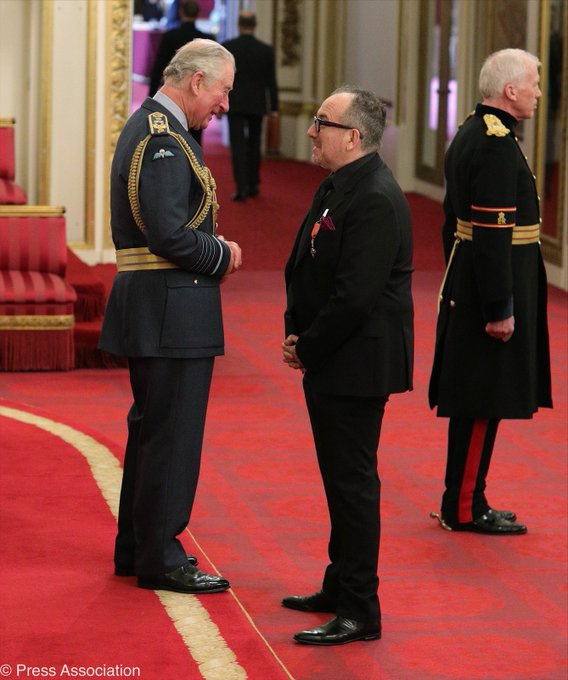 Elvis Costello gets OBE at Buckingham Palace
