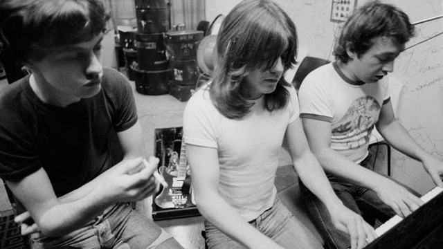 Angus Young, Malcolm Young, George Young.