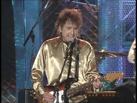 """Bob Dylan performs """"All Along the Watchtower"""" at the Concert for the Rock & Roll Hall of Fame in 1995."""